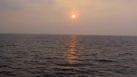 hikkaduwa : Slow motion aerial shot Tropical sunset. The sun sets over the ocean, the sea waves in the evening light Stock Footage