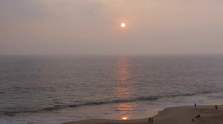 hikkaduwa : Slow motion aerial shot Tropical sunset. The sun sets over the ocean, the sea waves in the evening light, sandy beach in evening Stock Footage