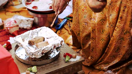 sherwani : Hindu woman pours oil over the nuts