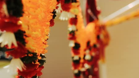 sherwani : Garlands made of exotic flowers hang from the ceiling