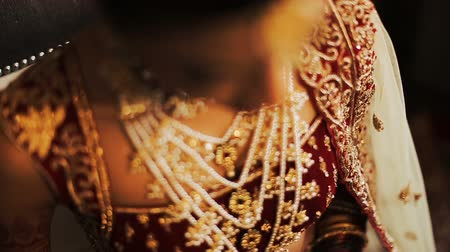 prepairing : Close-up of golden necklace on Indian brides neck Stock Footage