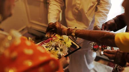 sherwani : Indian bride holds flowers in her arm