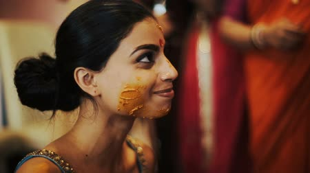 sherwani : Indian brides face covered with turmeric paste