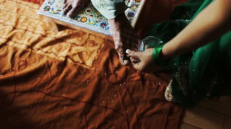 sherwani : Woman puts ring on another womans toe Stock Footage