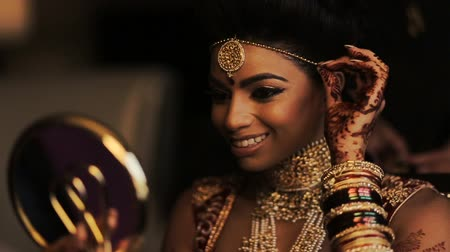prepairing : Blurred video of fabulous Indian bride looking in the mirror and smiling