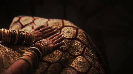 sherwani : Mehndi covers delicate Indian brides hands full of bracelets