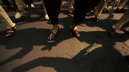 dhoti : Look from above at feet of Hindu men dancing on the street
