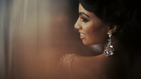 weddings : Hindu bride with crystal earrings looks over her shoulder