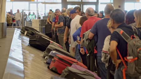 полоса : Luggage on carousel waiting for travel at the depature hall