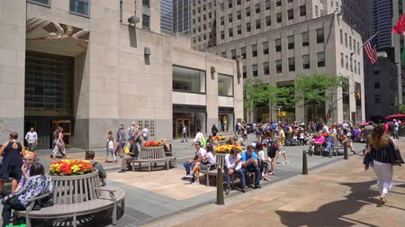 bronz : locals and tourists walking on Rockefellar Plaza in the heart of New York City