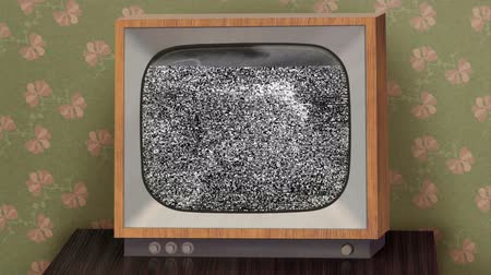 news tv : Retro b&w TV set showing news intro before switching to green (chroma key) background, then switching to TV test and finally switching off.   Stock Footage
