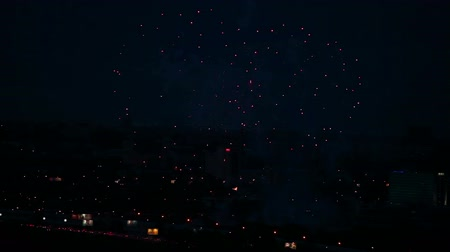 salvo : Fireworks flashing above the city at night. Stock Footage