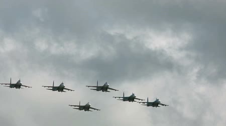 fighter : Sukhoi Su-27 jet fighters performing group aerobatics at Mochishe airshow, Novosibirsk