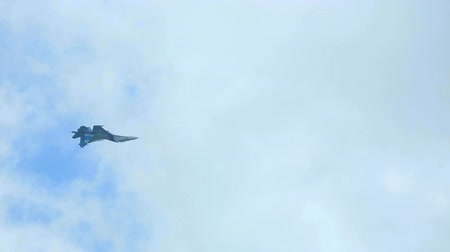 fighter : Su-27 Sukhoi jet fighter performing inside loop aerobatic maneuver at the airshow near Novosibirsk. Stock Footage
