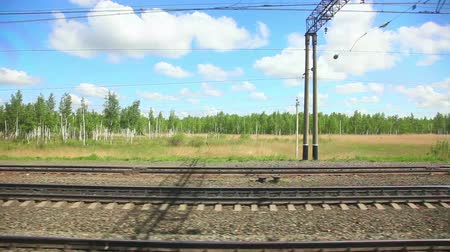 side view : View to the side railroad out of the window of moving coach. Stock Footage