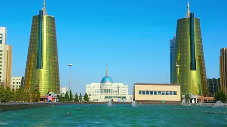Казахстан : View of golden towers of Ministry House and Ak-Orda Presidential Palace in Astana, Kazakhstan.