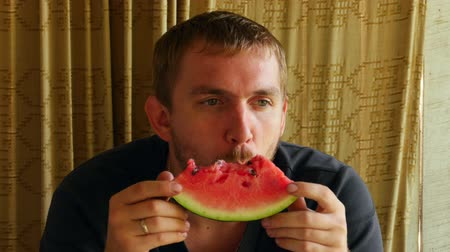 man eating : Man eating watermelon