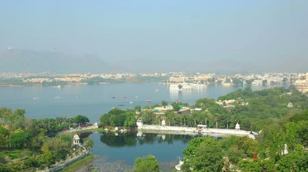 pichola : Panoramic view of the Indian city of Udaipur out of moving cableway wagon.