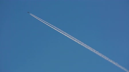 rotaları : Jet airplane with trail against the blue sky