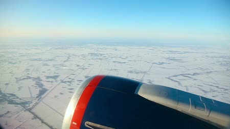 snowfield : After take-off from Novosibirsk airport. Snowfield - view through an airplane window.