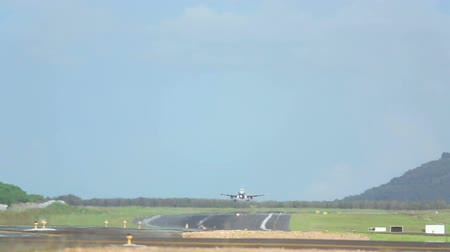 pist : Jet airplane touch down the runway in dusk, telephoto lens, International Phuket Airport, Thailand