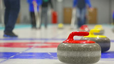 soutěže : Curling stones on ice