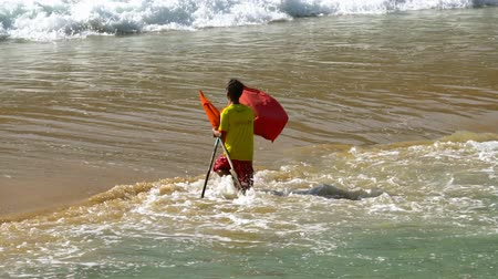 lifesavers : The flag warns swimmers not to enter the water