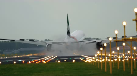 early morning : Emirates Boeing 777 landing Stock Footage
