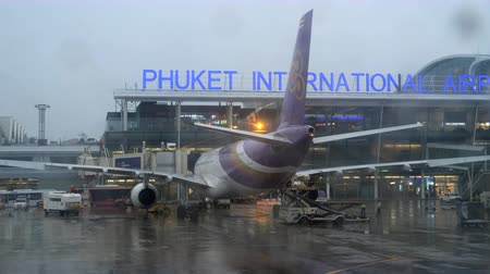 tow : Rainy weather at Phuket airport Stock Footage