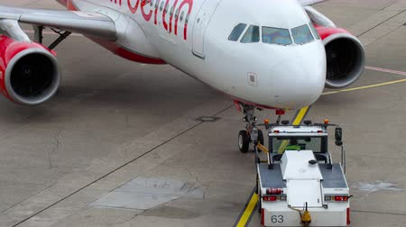 tow : Airberlin Airbus A320 towing Stock Footage