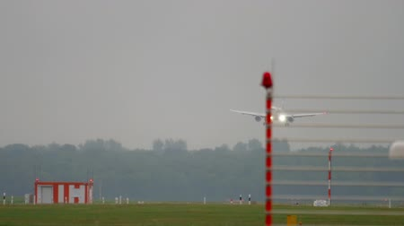 dusseldorf : Airplane landing at rainy weather