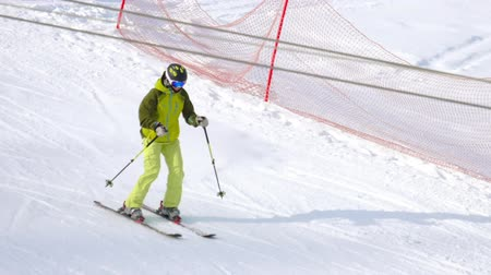 ski boots : Amateur skier downhill Stock Footage