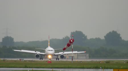 dusseldorf : Airplane taxiing at rainy weather