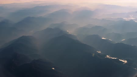 jet out : Beautiful view through airplane window, airplane flying above mountains Stock Footage
