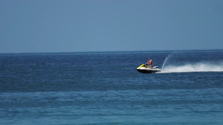jet ski : Man on a jet ski in the ocean