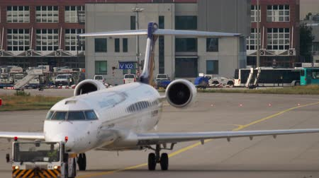 fraport : Bombardier CRJ-900 towing to service Stock Footage