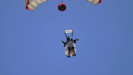 leaping : Wingsuite skydiver on parachute