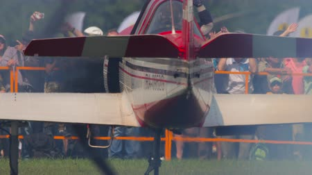 aerobatic : Pilot of YAK-52 sport plane greets airshow viewers Stock Footage