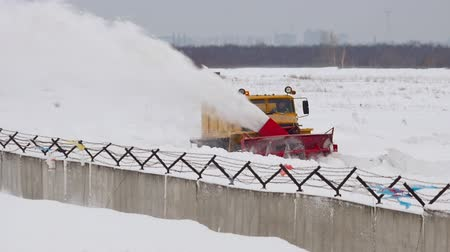 snow plow : Snowplow clears the runway