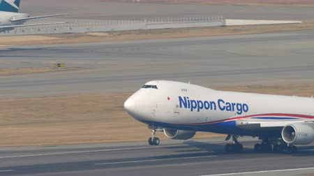 liftoff : Nippon Cargo boeing 747 departure from Hong Kong Stock Footage