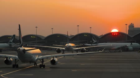 glass structure : Sunset at Chek Lap Kok Hong Kong International Airport
