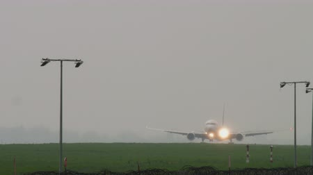 astana : Widebody airplane landing at rainy weather Stock Footage