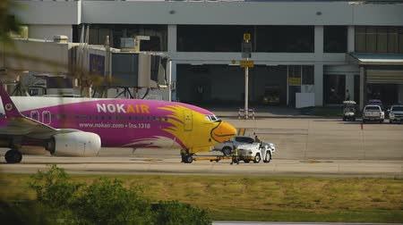 NOK Air Boeing 737 pushing back