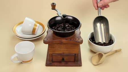 caffe : Edited sequence of coffee beans being ground in an old fashioned coffee grinder