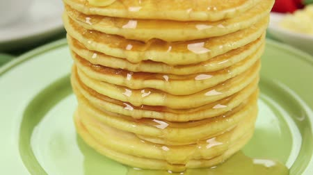 delicious : Honey dripping down the face of a pancake stack. Stock Footage