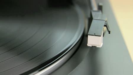 gravar : Edited sequence of a vinyl record being played on a turntable.  Stock Footage