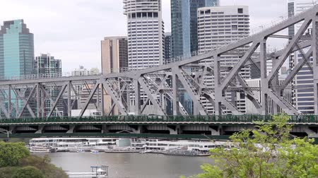 engineered : Medium wide shot of traffic crossing the Story Bridge in Brisbane Australia.