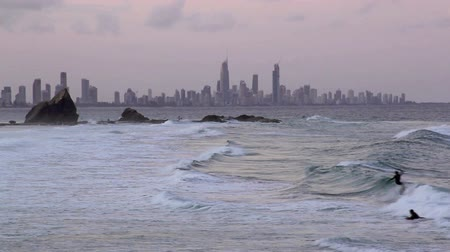 felhőkarcoló : View across Currumbin Rock looking towards Surfers Paradise Gold Coast Australia at sunset.