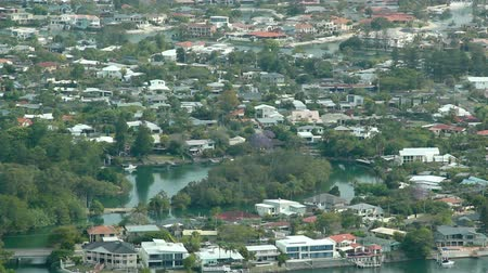 arrabaldes : Aerial shot of a typical Gold Coast suburb with river and housing in Queensland Australia.