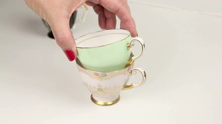 collectable : Putting three vintage tea cups into a stack.